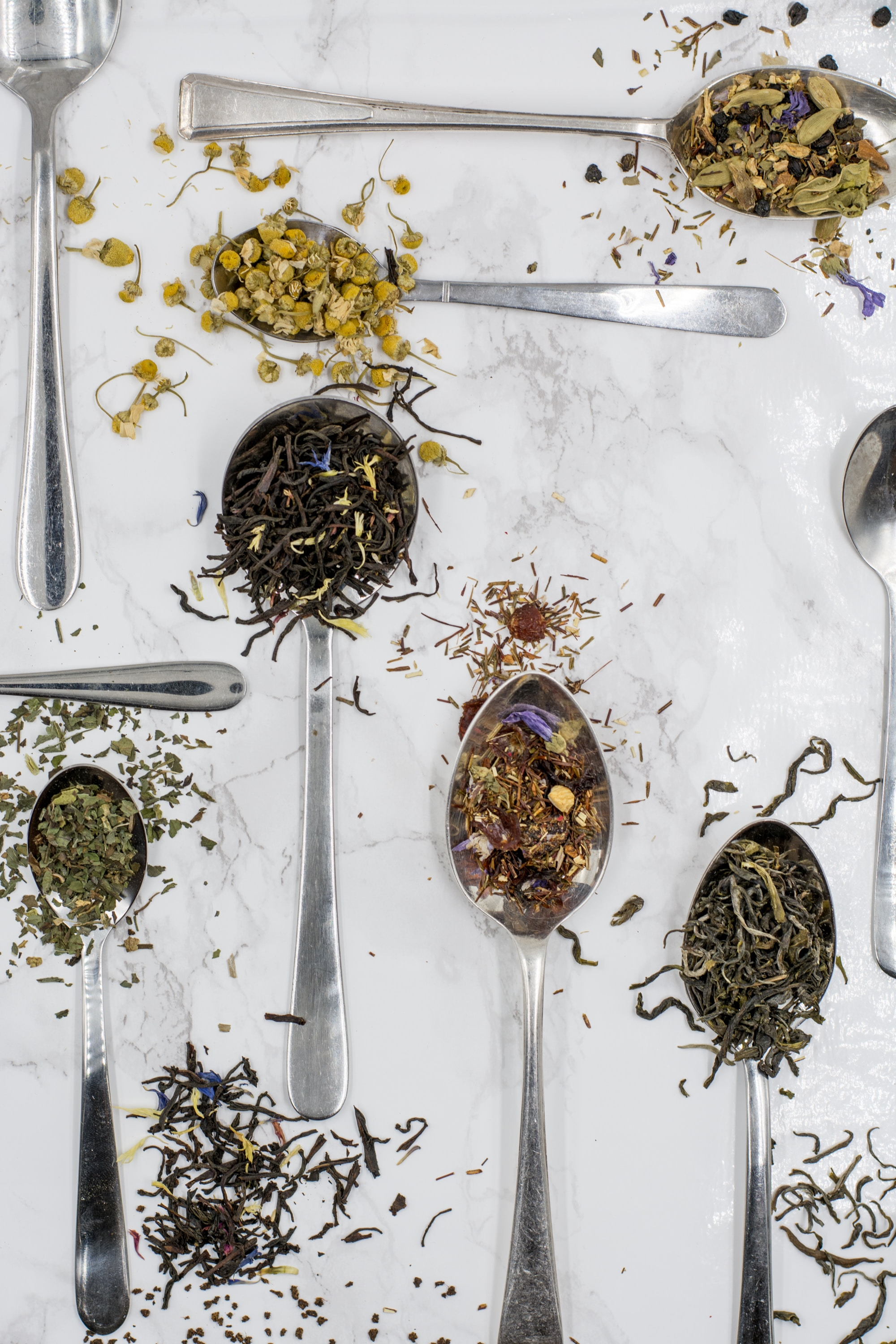 herbal teas on spoons