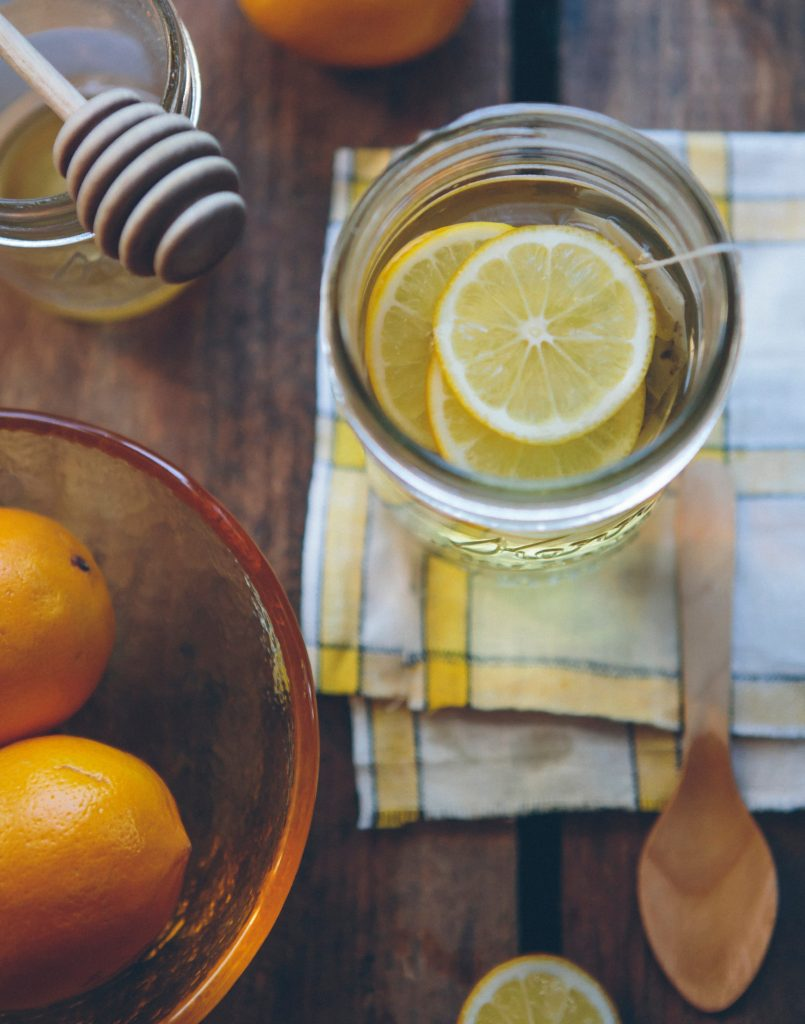 lemons and oranges in a mason jar with tea