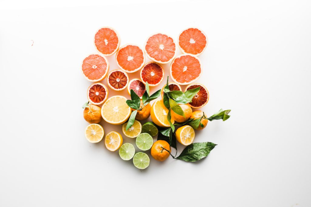 slices of citrus on a white background