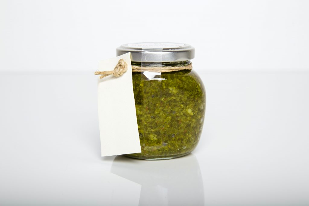 jar of herbs with blank label