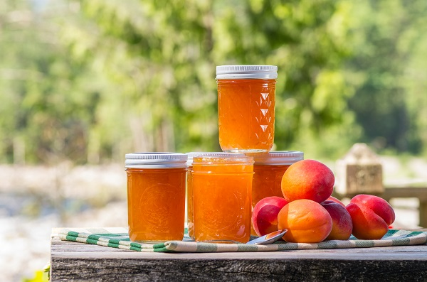 cans of peach preserves