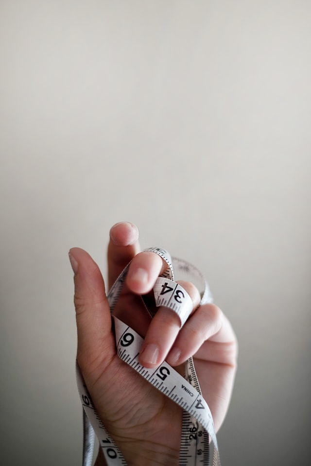 measuring tape wrapped around a hand