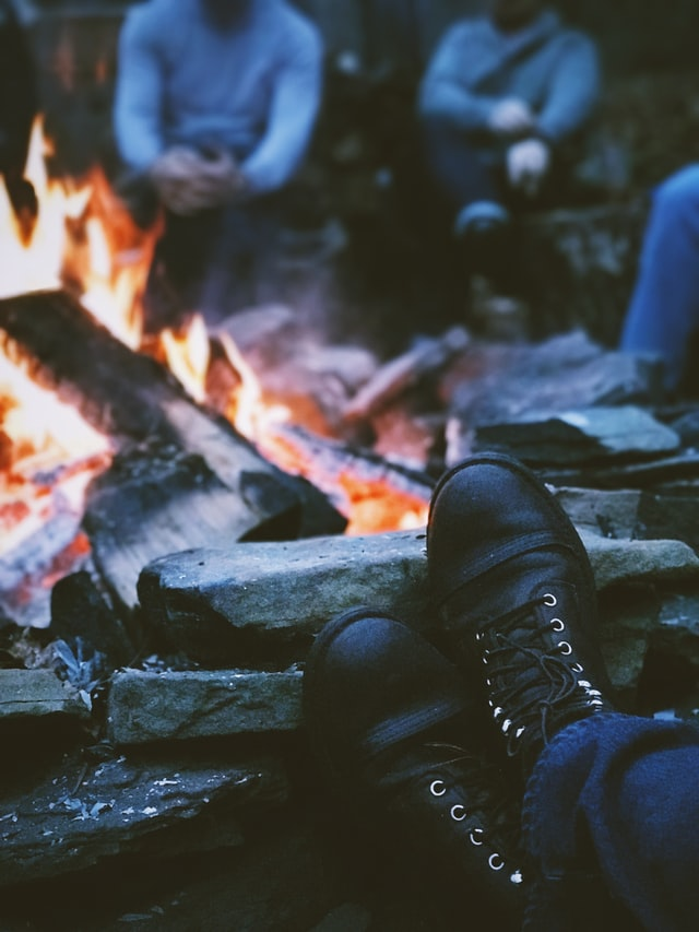 warming up boots by a fire
