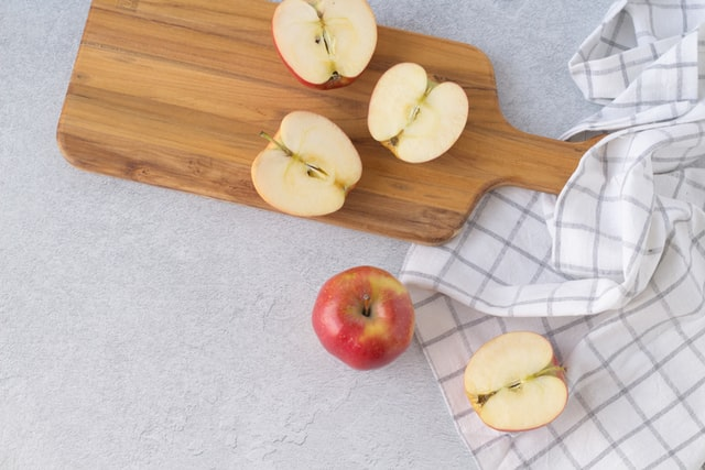red apples on a cutting board