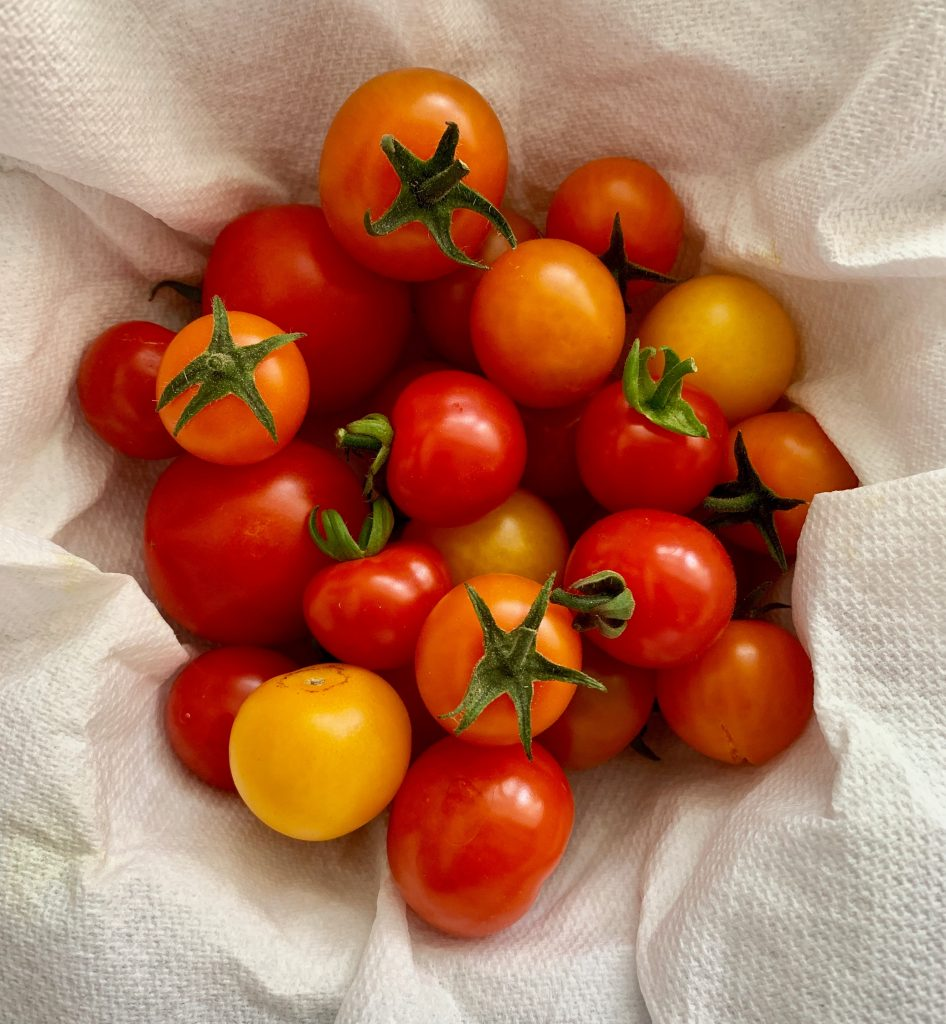 a pile of cherry tomatoes