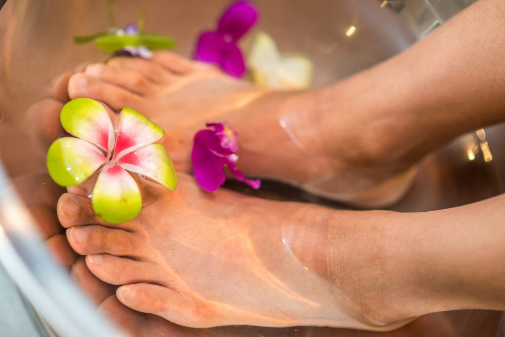 woman's feet in an herbal footbath