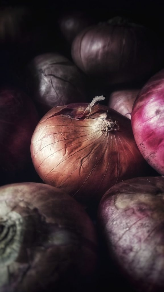macro image of a bunch of onions