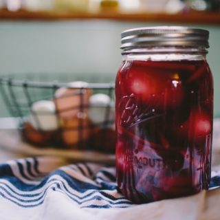 mason jar of pickled beets on a counter top