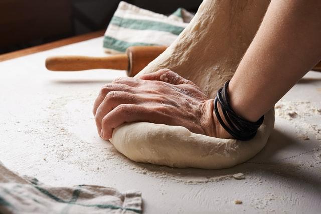 homemade pizza dough in a mixer