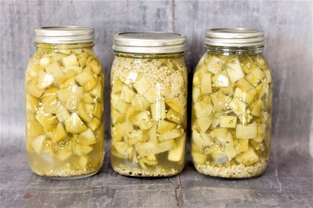 pickled green tomatoes in mason jars