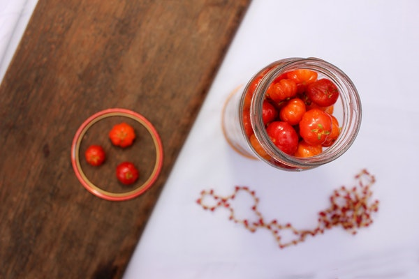 whole cherry tomatoes in a mason jar