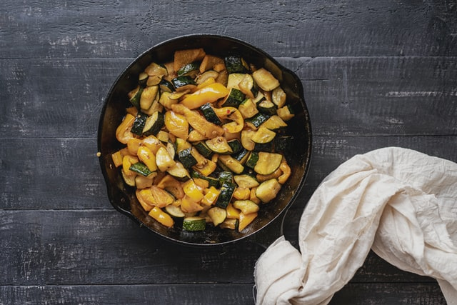 oil and food in a cast iron skillet