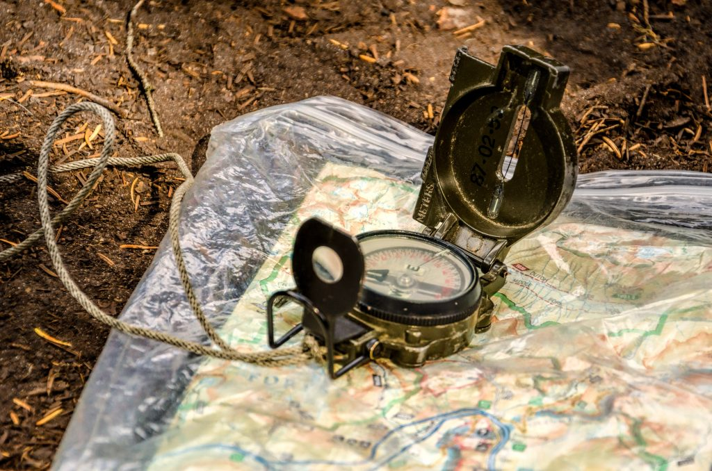 compass and map for navigation while hunting