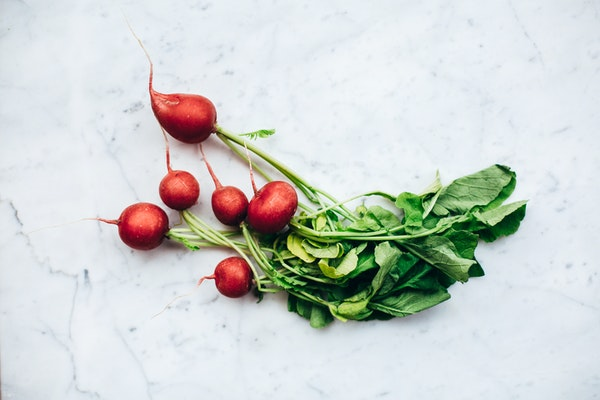 several red radishes on a white background
