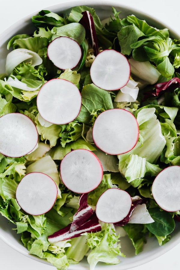 sliced radishes on a salad