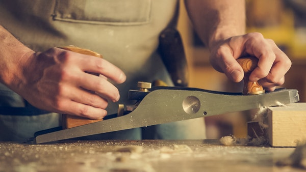 man doing woodworking