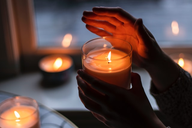 use a candle to find leaks around windows and doors
