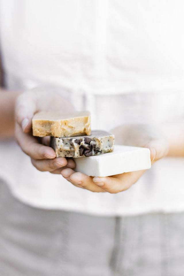 woman holding homemade soap bars
